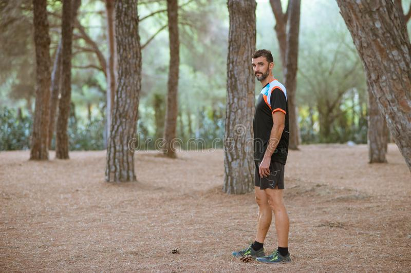 Sport man in the forest. Mountain, exercise, cross, lifestyle, health, outside, length, caucasian, jog, person, sprinter, working, active, jogger, male stock photo
