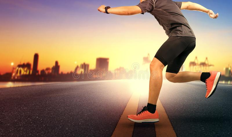 Sport man jumping cross road traffic line against beautiful suns stock photography