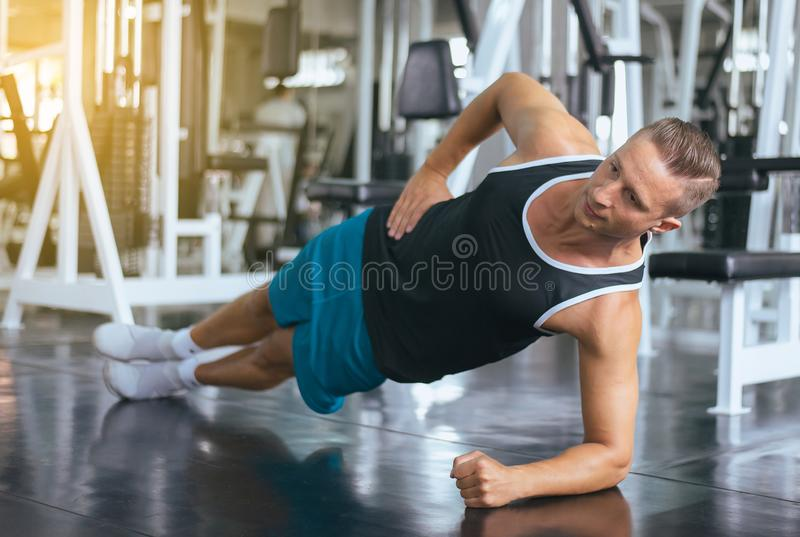Sport man stretching for warming up befor doing exercises training,Cross fit body muscular workout royalty free stock image