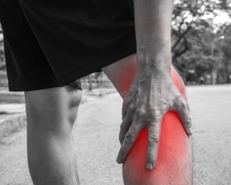 Sport men injury. male athlete jogger wearing man runner massaging calf muscle before workout.  stock photography