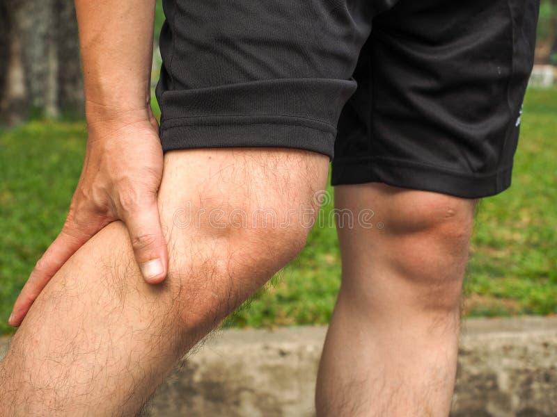 Sport men injury. male athlete jogger wearing man runner massaging calf muscle before workout.  royalty free stock image
