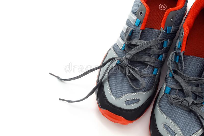 Sport men`s running shoes or for everyday walking on white background stock image