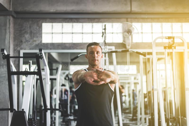 Sport men static stretching for warming up before doing wrist exercises training. Sport man static stretching for warming up before doing wrist exercises royalty free stock photos