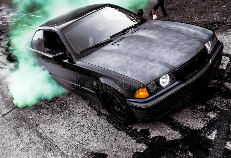Moldova 25.09.2019. Sport modern Stance E36 BMW Car racing car drifting with smoke drift burnout, Huge green clouds royalty free stock photo