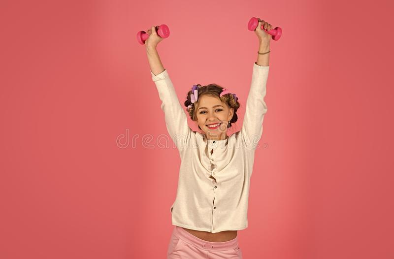 Sport, morning exercise, weight lifting, pink background. stock images