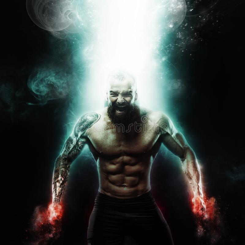Sport and motivation wallpaper on dark background. Power athletic guy bodybuilder. Fire and energy stock photos