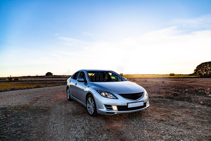 Sport noname car parked in a field on country road stock photo