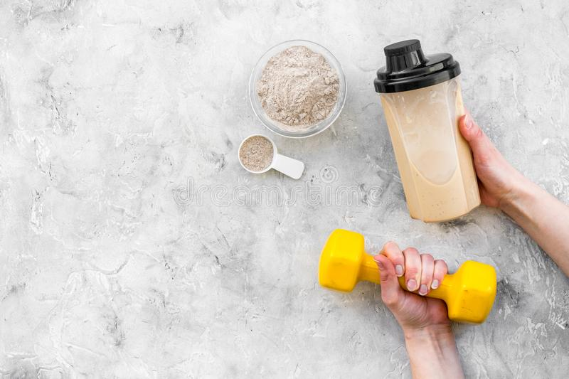 Sport nutrition set with protein powder for cocktail and bars gray stone background top view space for text stock image