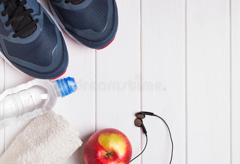 Sport outfit on the white wooden backgound. Top view stock images