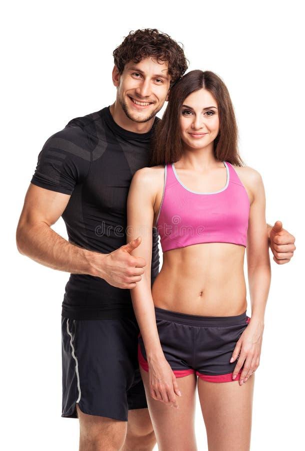 Sport para - mężczyzna i kobieta po sprawności fizycznej ćwiczymy na bielu zdjęcie stock