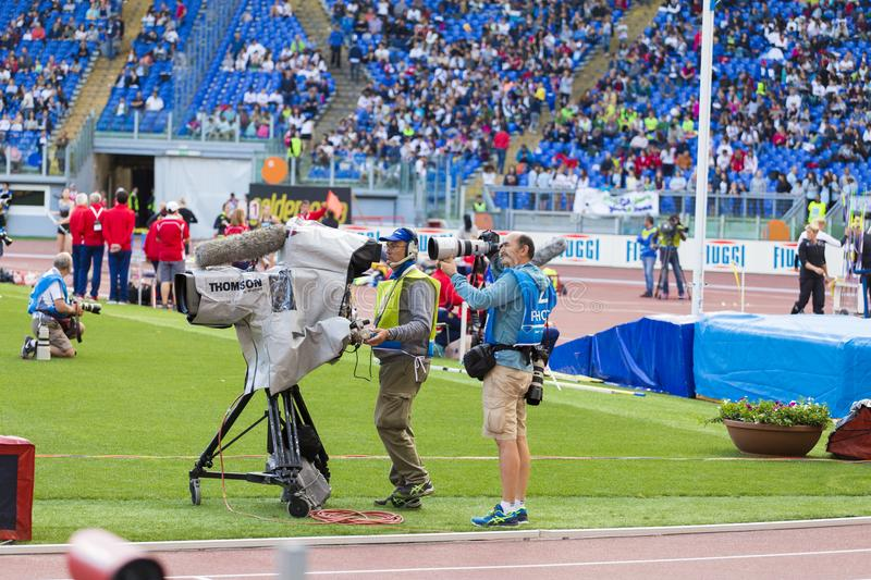 Sport photographer and cameraman at Diamon League. In Rome, Italy in 2016 stock photography