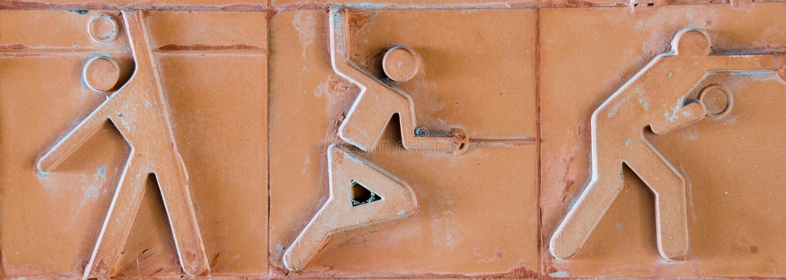 Sport pictogram. Sport icon set on earthenware brick.  royalty free stock images