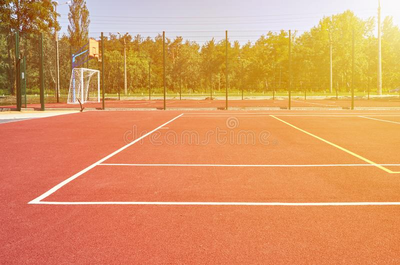 Sport playground for football and basketball, rubber stadium for training, sunlight effect.  royalty free stock photography