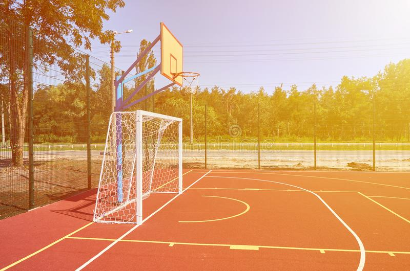 Sport playground for football and basketball, rubber stadium for training, sunlight effect.  stock image