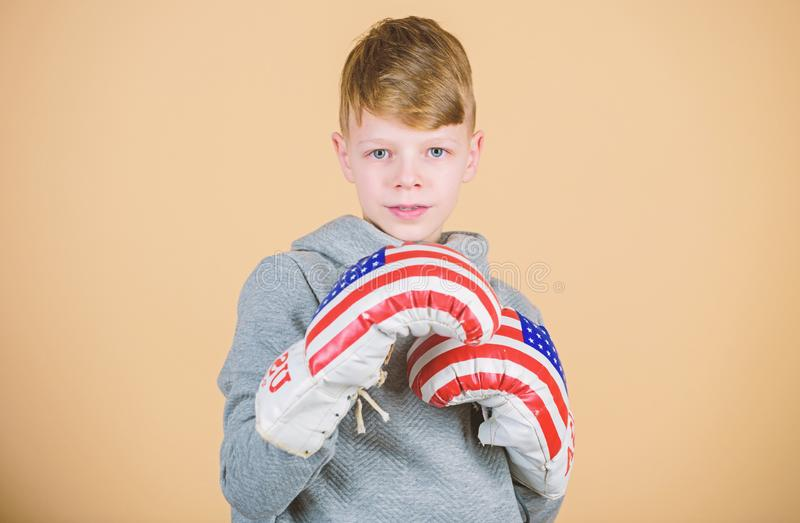 Sport. punching knockout. Childhood activity. Fitness diet. energy health. workout of small boy boxer. Sport success. Sportswear fashion. usa independence day stock image