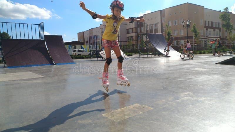 Girl on roller skates stock image