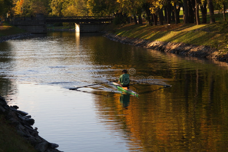 Sport rower in canal stock image