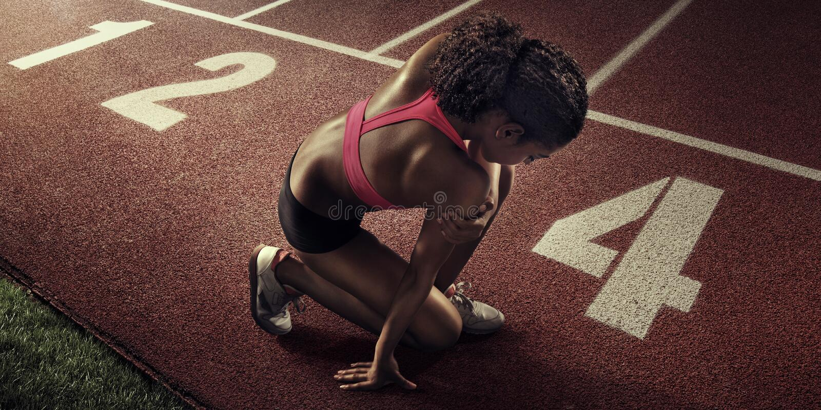 Sport. Runner. Young sportswoman stretching and preparing to run royalty free stock photos