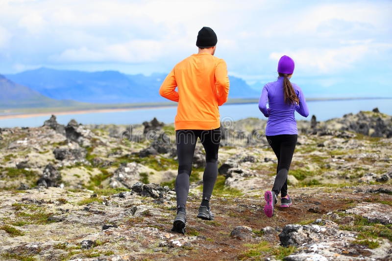 Sport running - runners on cross country trail royalty free stock image