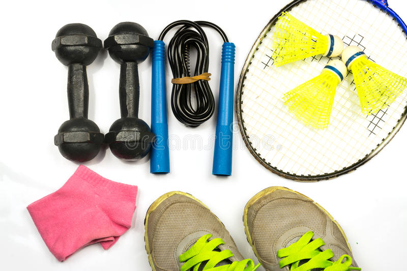 Sport. Shoe,badminton,weight ,jump rope and pink socks on white background stock photos