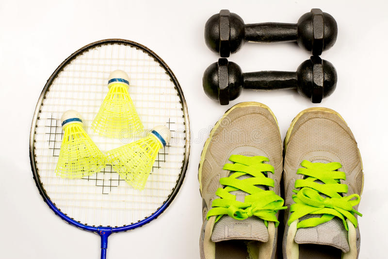 Sport. Shoe,badminton,weight ,jump rope and pink socks on white background royalty free stock photos