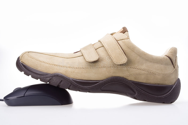 Sport shoe and a mouse stock photography