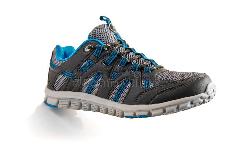 Sport shoe. Outdoors trainers over a white background stock photos