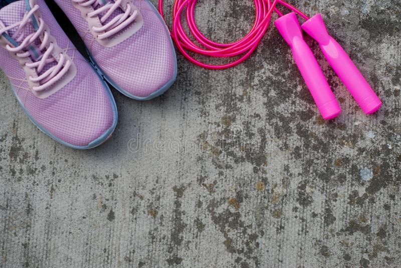 Sport shoes and equipment for healthy shape. Sneakers with skipping rope. Healthy lifestyle concept. Sport shoes and equipment for healthy shape. Sneakers with stock photography