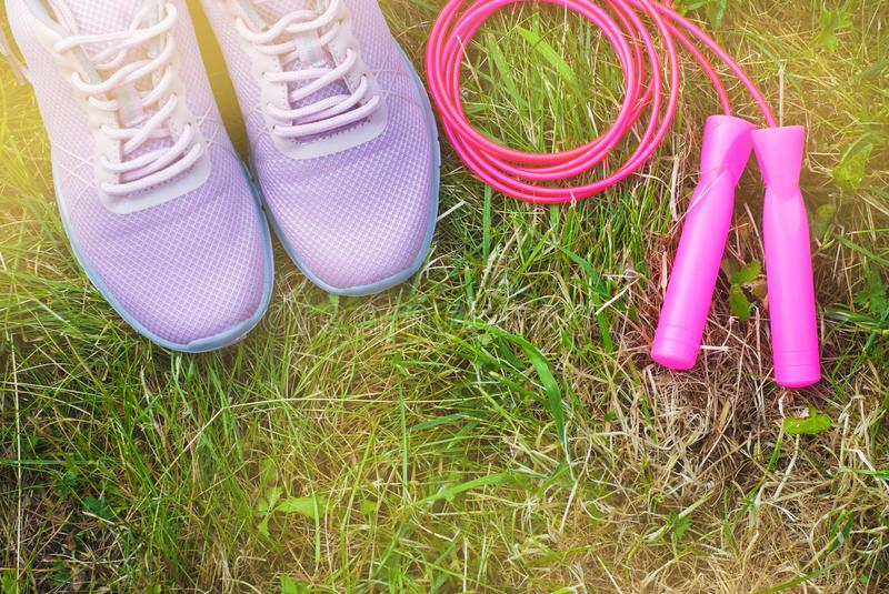Sport shoes and equipment for healthy shape. Sneakers with skipping rope. Healthy lifestyle concept. Sport shoes and equipment for healthy shape. Sneakers with royalty free stock images