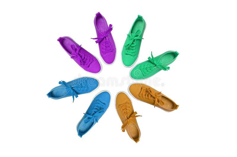 Sport shoes. Many pairs of sneakers stand in the shape of circle. White isolate royalty free stock photos
