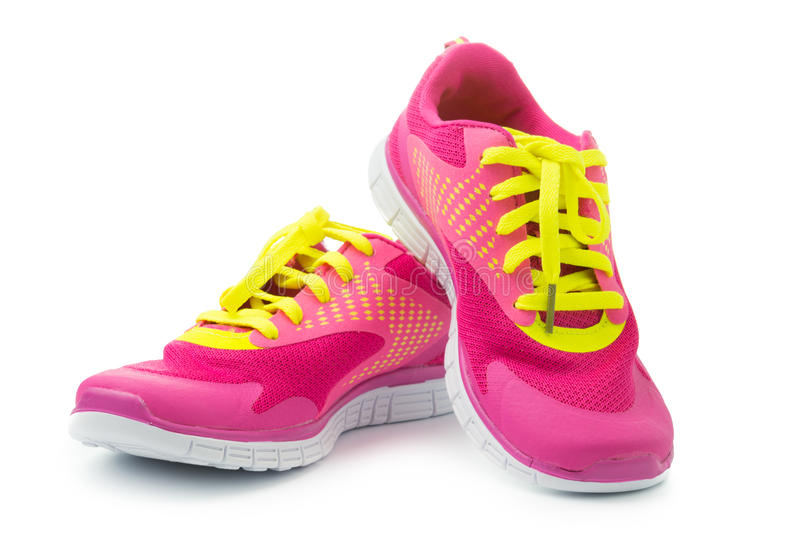 Sport shoes. Pair of pink sport shoes on white background stock image