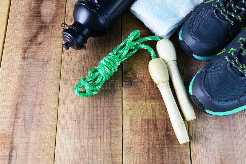 Sport shoes and towel, skipping rope, bottle of water on wooden. Sport shoes and towel, skipping rope, bottle of water stock photos