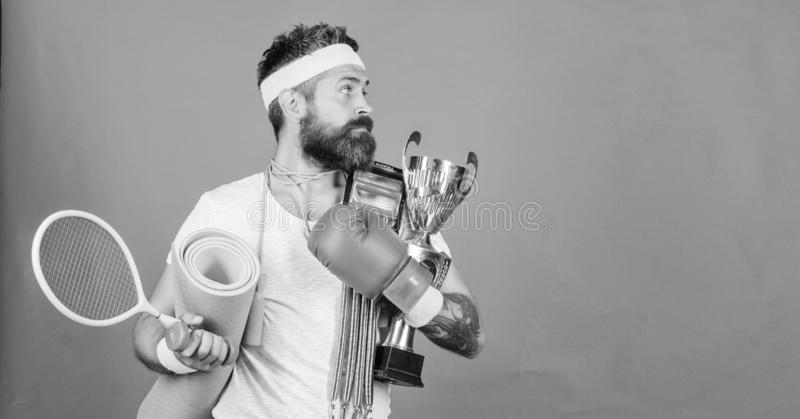 Sport shop assortment. Sport concept. Get body ready for summer. Choose sport you like. Man bearded athlete hold sport. Equipment jump rope fitness mat boxing stock photo