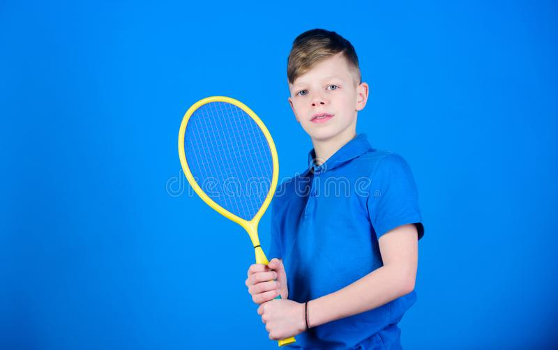 Sport shop. Little boy. Fitness diet brings health and energy. Sport game shop. Gym workout of teen boy. Happy child. Play tennis. Tennis player with racket stock images
