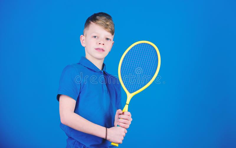 Sport shop. Little boy. Fitness diet brings health and energy. Sport game shop. Gym workout of teen boy. Happy child. Play tennis. Tennis player with racket royalty free stock photos