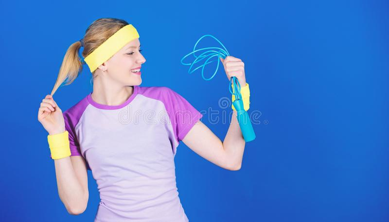 Sport skipping rope equipment. Athletic fitness. Strong muscles and power. Sporty woman training in gym with skipping. Rope. Health diet. Success. Happy woman stock photography