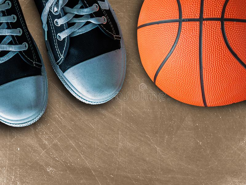 Sport sneakers and basket ball. With free space for text royalty free stock image