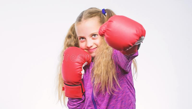 Sport and sportswear fashion. training with coach. Fight. Boxer child workout, healthy fitness. knockout and energy. Sport success. little girl in boxing stock image