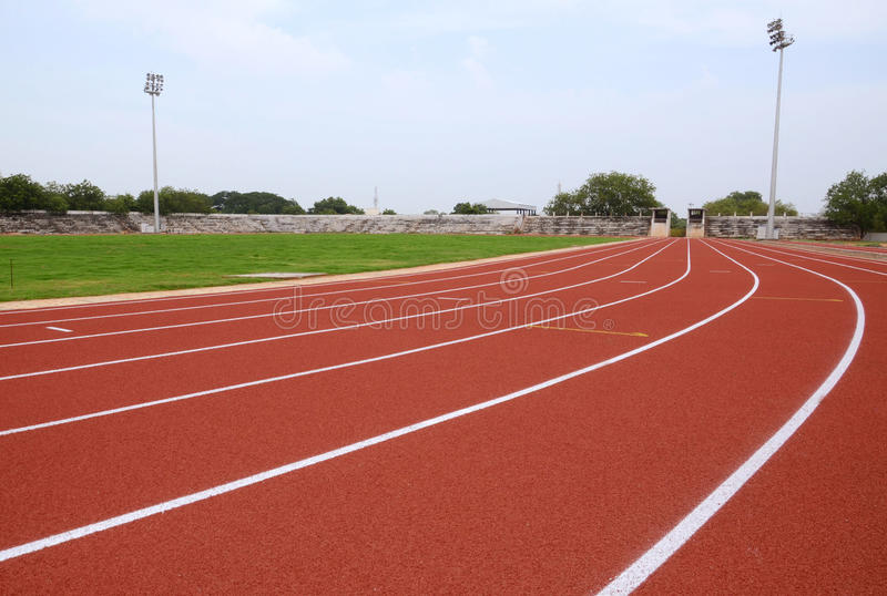 SPORT STADIUM WITH RUNNING TRACKS STRIP. Part of sport stadium with running tracks strip stock image