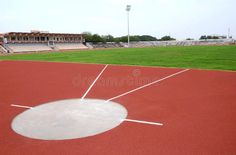 SPORT STADIUM WITH SHOT PUT STRIP. Part of sport stadium with shotput strip stock photos