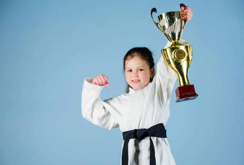 Sport success in single combat. practicing Kung Fu. happy childhood. winner little girl in gi sportswear. small girl royalty free stock image