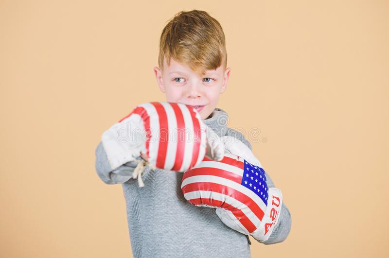 Sport success. sportswear fashion. workout of small boy boxer. punching knockout. Free your mind. Fitness diet. energy. Health. usa independence day. Happy royalty free stock photography