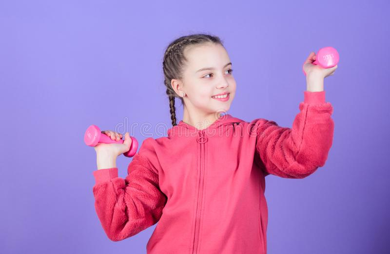 Sport success. workout of small girl hold dumbbell. weight lifting for muscules. Sport activity. Fitness diet for energy. Health. Happy child sportsman with royalty free stock images