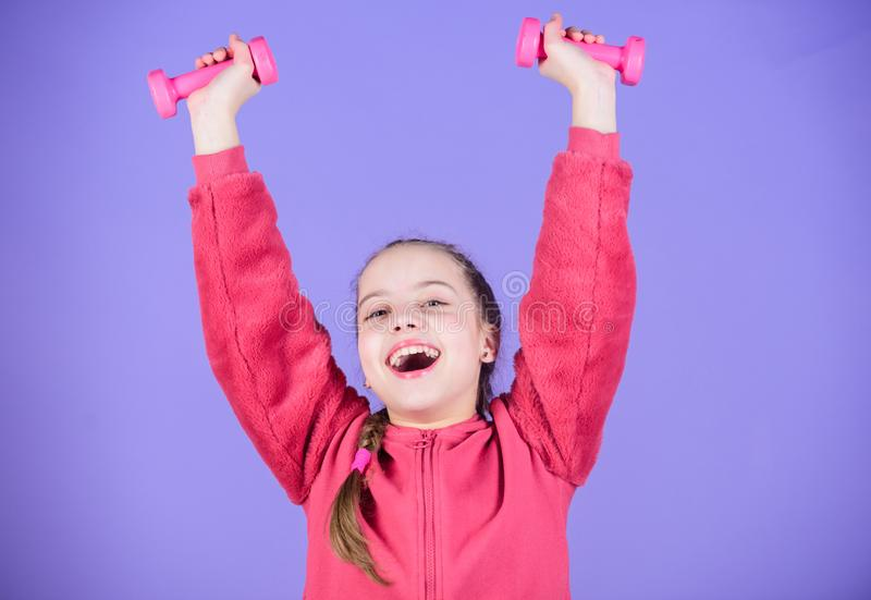 Sport success. workout of small girl hold dumbbell. weight lifting for muscules. Childhood activity. Fitness diet for. Energy health. Happy child sportsman with stock photos