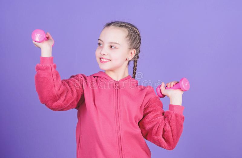Sport success. workout of small girl hold dumbbell. weight lifting for muscules. Sport activity. Fitness diet for energy. Health. Happy child sportsman with stock images