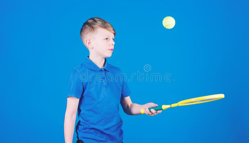 Sport tennis game success. game workout of teen boy. Tennis game player with racket and ball. activity of Llttle boy. Fitness diet brings health and energy stock photo