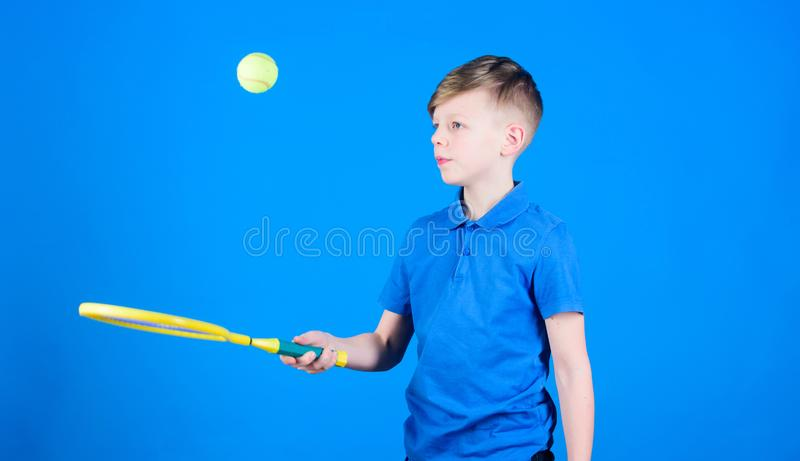 Sport tennis game success. game workout of teen boy. Tennis game player with racket and ball. activity of Llttle boy royalty free stock photo