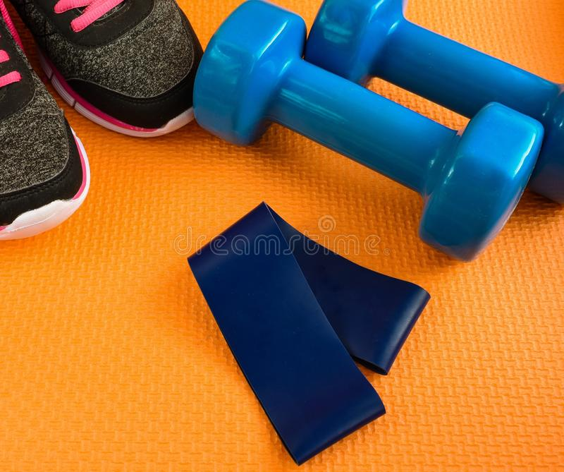 Dumbbells and fitness elastic band. Sport training bodybuilding dumbbells and elastic band fitness gym strength health body healthy muscle hand workout sports royalty free stock images