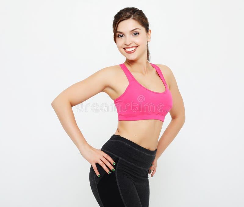 Sport und Leutekonzept: Nette attraktive junge Eignungsfrau in den Spitzen- und schwarzen Gamaschen lizenzfreie stockbilder
