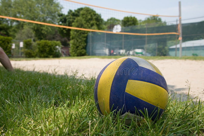 Sport volleyball on grass stock images